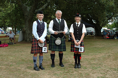 2016 Prize winners B Grade Piobaireachd Solo Piping, Paeroa. Left to right: Anna Smart 2nd, Mr Iain Blakeley judge, Juliet Johnson 1st