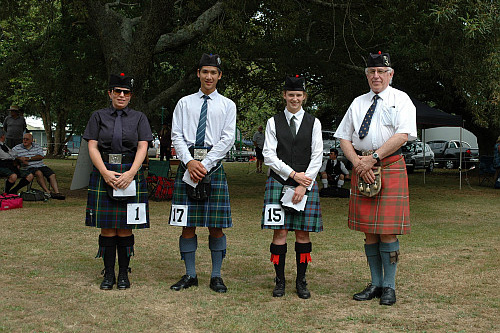 2016 Prize winners C Grade Strathspey and Reel. L to r: Lorraine Gow 3rd, Tim Chia 2nd, Anita Bentley 1st with Mr Mervyn Appleton judge.