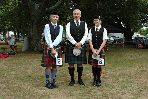 2016 Prize winners B Grade March, Strathspey and Reel, Solo Piping Paeroa. Left to right: Anna Smart 2nd, Mr Iain Blakeley judge, Juliet Johnson 1st.